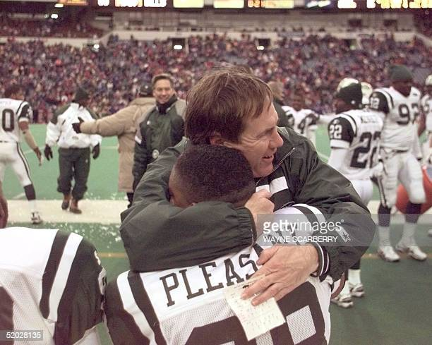 New York Jets' defensive coordinator Bill Belichick hugs Jets defensive end Anthony Pleasant at the conclusion of the Jets' 1710 win over the Buffalo...