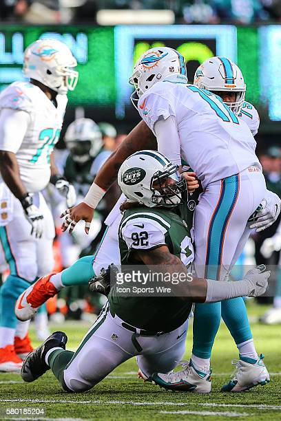 New York Jets defensive end Leonard Williams hits Miami Dolphins quarterback Ryan Tannehill during the second quarter of the game between the New...