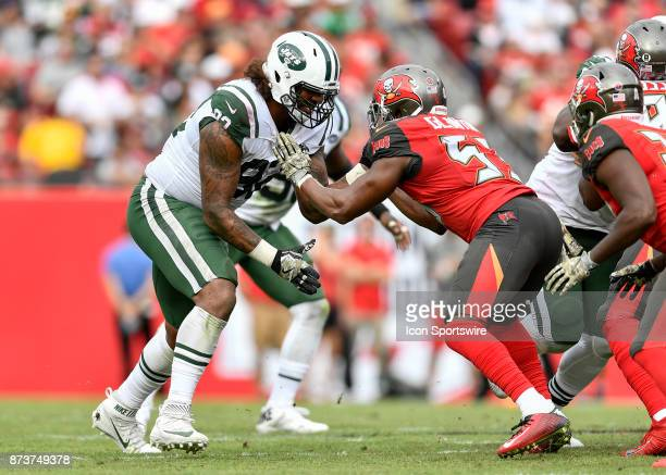 New York Jets defensive lineman Leonard Williams is blocked by Tampa Bay Buccaneers linebacker Adarius Glanton during the second half of an NFL game...