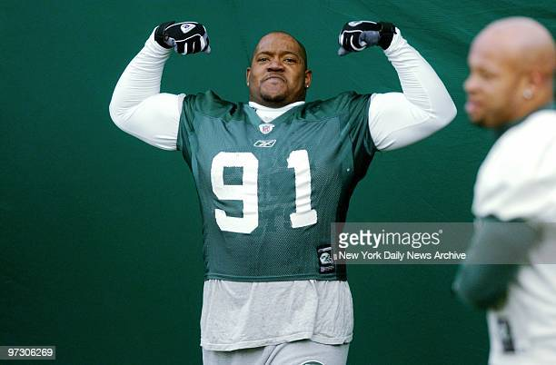 New York Jets' defensive tackle Josh Evans flexes his muscles at the team's practice facility in Hempstead LI The Jets are preparing for Saturday's...