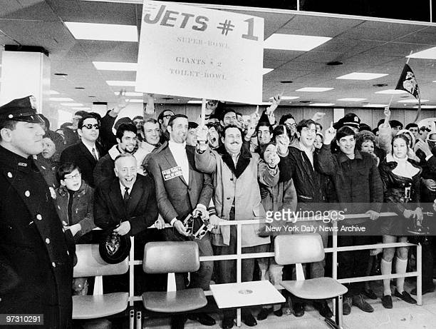 New York Jets fans cheer as their favorite team arrive at Kennedy airport after their Super Bowl III win over the Colt