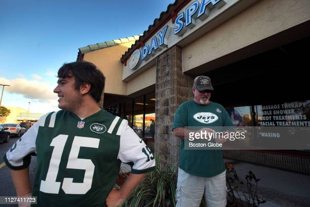 New York Jets fans Matthew Gizze and Mike Brown visit the Orchids of Asia Day Spa in Jupiter FL where New England Patriots owner Robert Kraft is...