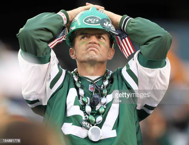 New York Jets fans watches the final minutes of the game against the Miami Dolphins on October 28 2012 at MetLife Stadium in East Rutherford New...