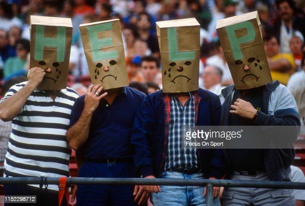 new-york-jets-fans-wear-paper-bags-over-their-heads-during-an-nfl-picture-id1152298712