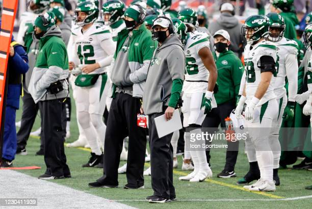 New York Jets head coach Adam Gase checks a replay during a game between the New England Patriots and the New York Jets on January 3 at Gillette...