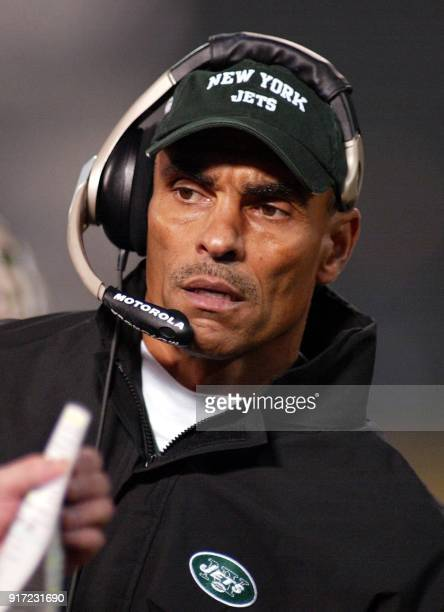 New York Jets head coach Herman Edwards watches his team from the sidelines during their AFC playoffs game against the Oakland Raiders 12 January...