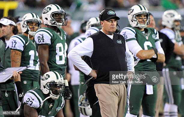 New York Jets head coach Rex Ryan and New York Jets quarterback Mark Sanchez react to an extra point attempt after fumble and touchdown in the first...