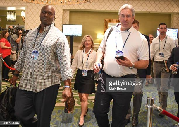 New York Jets head coach Todd Bowles and Philadelphia Eagles head coach Doug Pederson head to meeting during the 2018 NFL Annual Meetings at the Ritz...