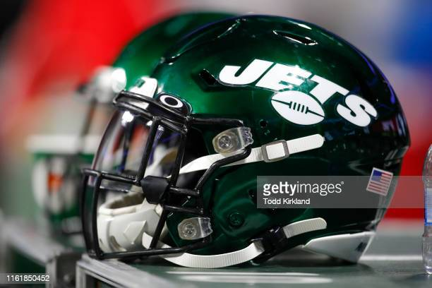 New York Jets helmet sits on an equipment case during the second half of an NFL preseason game against the Atlanta Falcons at Mercedes-Benz Stadium...