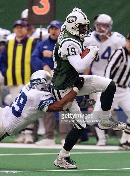 New York Jets' Keyshawn Johnson makes a catch for a first down as the Seattle Seahawks' Darrin Smith tackles him at Giants Stadium Jets won 199