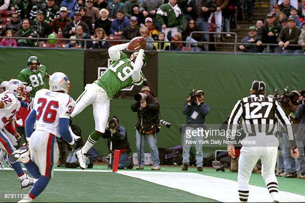 New York Jets' Keyshawn Johnson makes the catch near the end zone during game against the New England Patriots