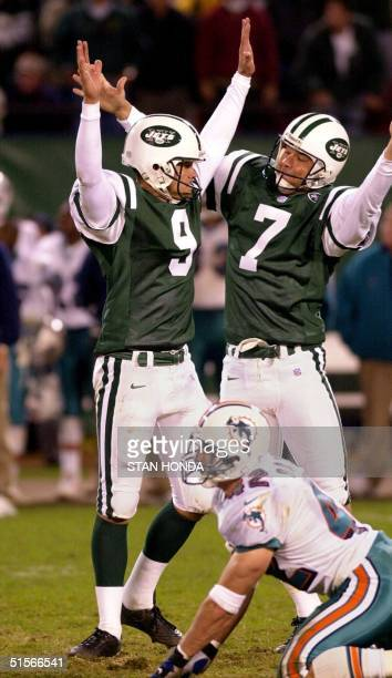 New York Jets kicker John Hall and holder Tom Tupa celebrate after Hall kicked a 40yard field goal in sudden death overtime to beat the Miami...