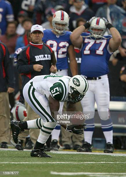 New York Jets LB Jonathan VIlma recovers a fumble in action during the Jets' 28-20 win over the Bills at Ralph Wilson Stadium, Orchard Park, New...