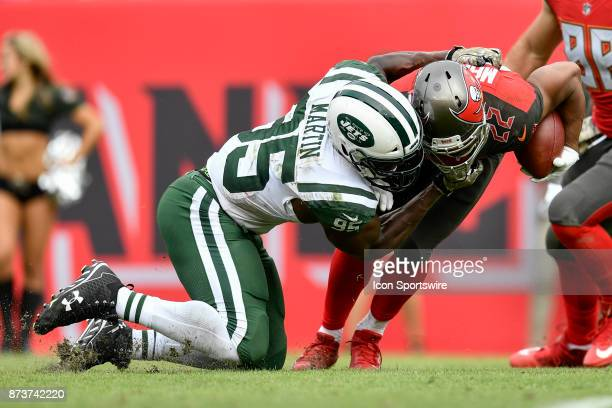 New York Jets linebacker Josh Martin brings down Tampa Bay Buccaneers running back Doug Martin during the second half of an NFL game between the New...