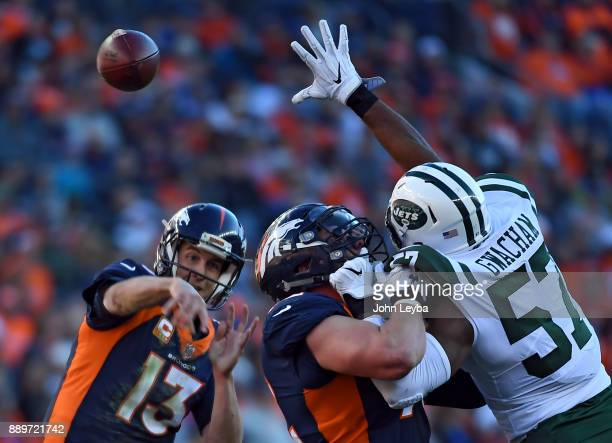 New York Jets linebacker Obum Gwacham attempts to blocks a pass by Denver Broncos quarterback Trevor Siemian as he gets blocked by offensive tackle...