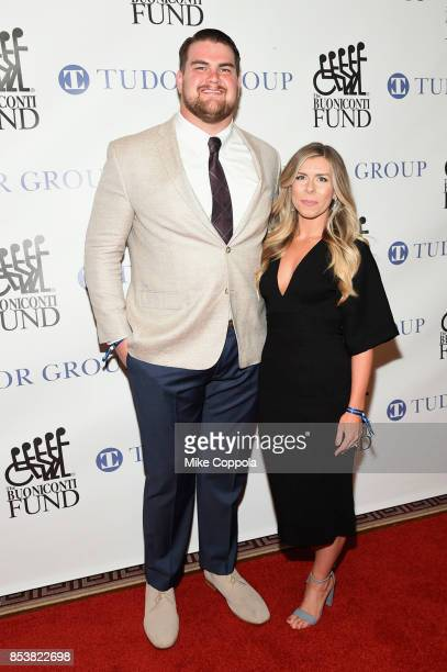 New York Jets Offensive Lineman Brent Qvale and Melissa Qvale attend the 32nd Annual Great Sports Legends Dinner To Benefit The Miami...