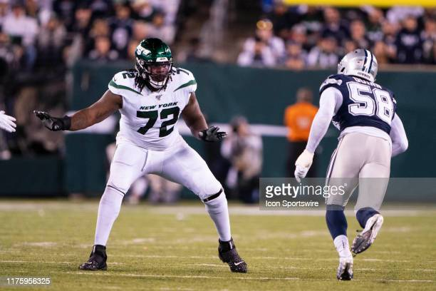 New York Jets Offensive Tackle Brandon Shell looks to block Dallas Cowboys Defensive End Robert Quinn during the second half of the game between the...