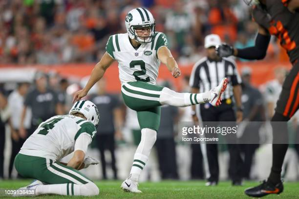 New York Jets place kicker Jason Myers kicks an extra point out of the hold of New York Jets punter Lachlan Edwards during the second quarter of the...