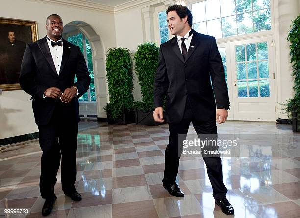 New York Jets players D'Brickashaw Ferguson and Mark Sanchez arrive at the White House for a state dinner May 19 2010 in Washington DC President...