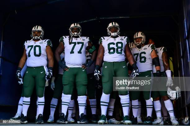 New York Jets players from left Dakota Dozier James Carpenter Kelvin Beachum and Wesley Johnson prepare to run onto the field during player...