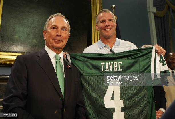 New York Jets Quarterback Brett Favre and New York City Mayor Michael Bloomberg pose for a photo during a press conference to Welcome Brett Favre to...