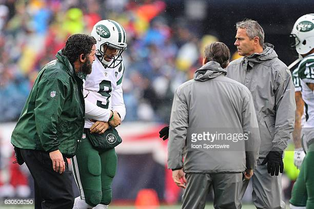 New York Jets quarterback Bryce Petty leaves the field with a shoulder injury during the National Football League game between the New England...