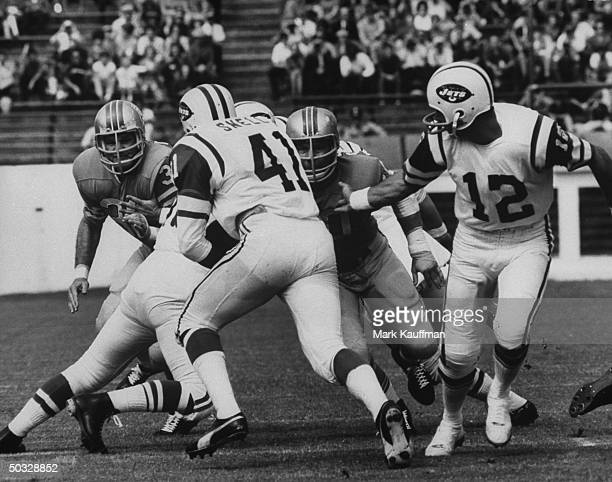 New York Jets quarterback Joe Namath handing off the football during a game against the Houston Oilers