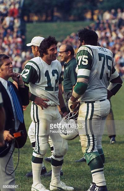 New York Jets' quarterback Joe Namath talks to teammate Winston Hill during a game