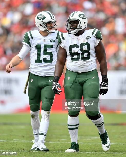 New York Jets quarterback Josh McCown and New York Jets tackle Kelvin Beachum have a laugh during the first half of an NFL game between the New York...