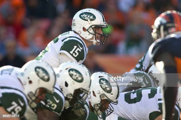 New York Jets quarterback Josh McCown calls a play during the New York Jets vs Denver Broncos football game at Sports Authority Field in Denver CO on...