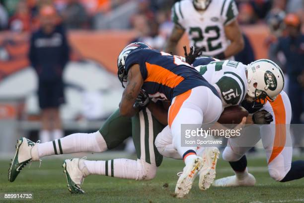 New York Jets quarterback Josh McCown dives forward during the New York Jets vs Denver Broncos football game at Sports Authority Field in Denver CO...