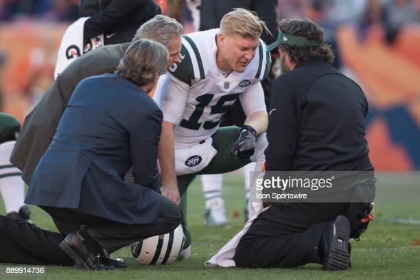 New York Jets quarterback Josh McCown is attended to by medical staff during the New York Jets vs Denver Broncos football game at Sports Authority...