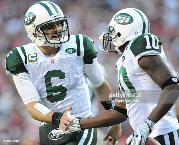New York Jets quarterback Mark Sanchez congratulates New York Jets wide receiver Santonio Holmes after a touchdown catch in the fourth quarter of the...