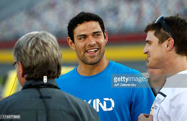 New York Jets quarterback Mark Sanchez stands on the starting grid prior to the NASCAR Camping World Truck Series North Carolina Education Lottery...