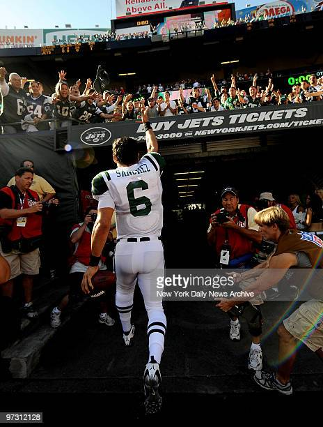 New York Jets' quarterback Mark Sanchez throws his hat to the fans after victory over New England Patriots. Jets won, 16-9.