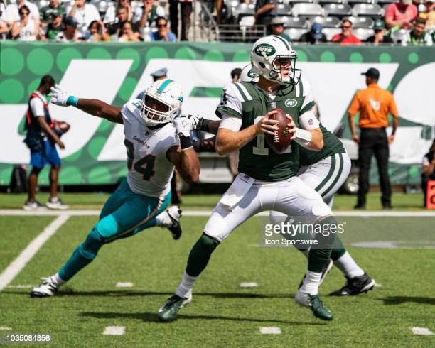 New York Jets Quarterback Sam Darnold looks to pass the ball with Miami Dolphins Defensive End Robert Quinn in pursuit during the second quarter of a...