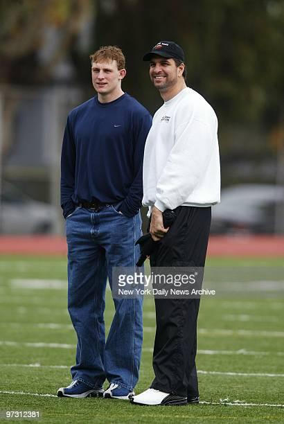 New York Jets' quarterbacks Chad Pennington and Vinny Testaverde talk during practice at Burlingame High School in Burlingame Calif Testaverde will...