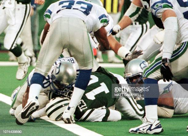 New York Jets quarterfback Vinny Testaverde lies on the ground with his head on the goal line and the ball under his body in his left hand after...