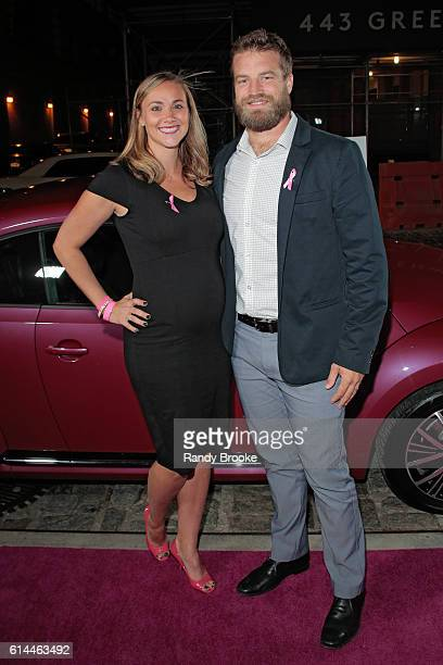 New York Jets quaterback Ryan Fitzpatrick poses with his wife Liza Barber outside during The Pink Agenda 2016 Gala arrivals at Three Sixty on October...