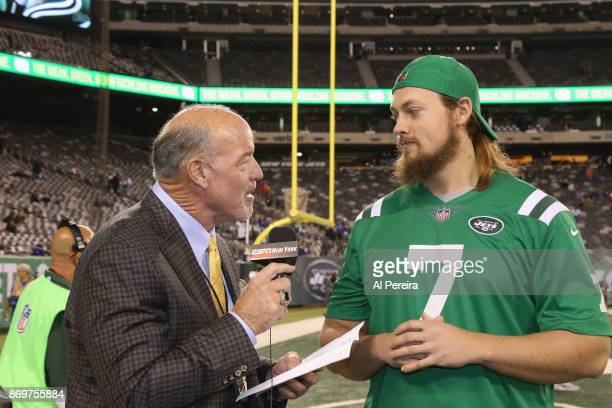 New York Jets radio personality Marty Lyons interviews WWE wrestler Big Cass when he attends the Buffalo Bills at New York Jets game at MetLife...