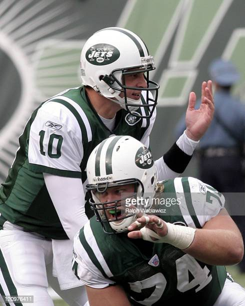 New York Jets rookie center Nick Mangold points out a blocking assignment as quarterback Chad Pennington looks over the defense during their 31 to 24...