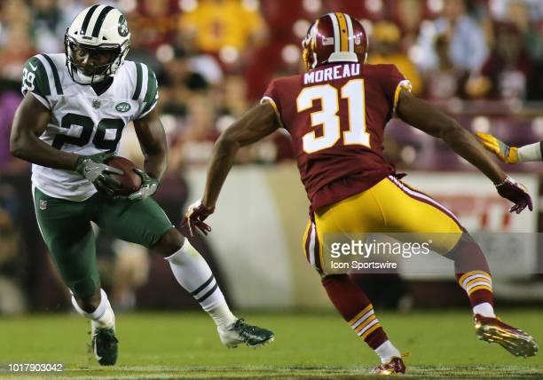 New York Jets running back Bilal Powell in action against Washington Redskins cornerback Fabian Moreau during an NFL preseason match between the...