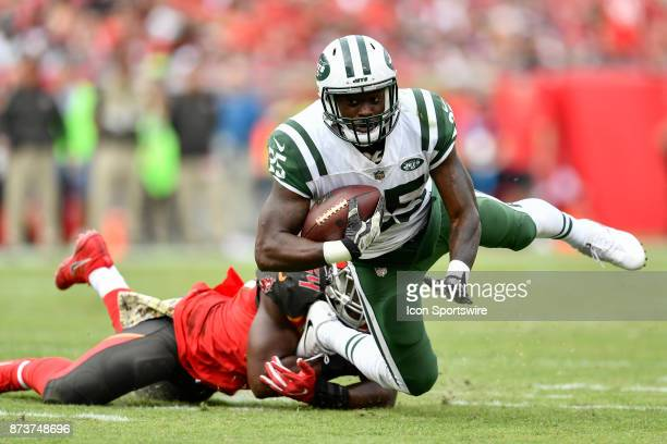 New York Jets running back Elijah McGuire is tripped up by Tampa Bay Buccaneers linebacker Lavonte David during the first half of an NFL game between...