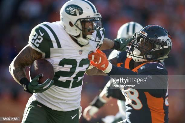 New York Jets running back Matt Forte stiff arms Denver Broncos linebacker Von Miller during the New York Jets vs Denver Broncos football game at...