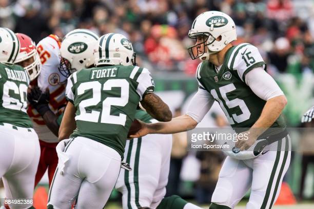 New York Jets Running Back Matt Forte takes a hand off from New York Jets Quarterback Josh McCown during the first half of a regular season NFL game...