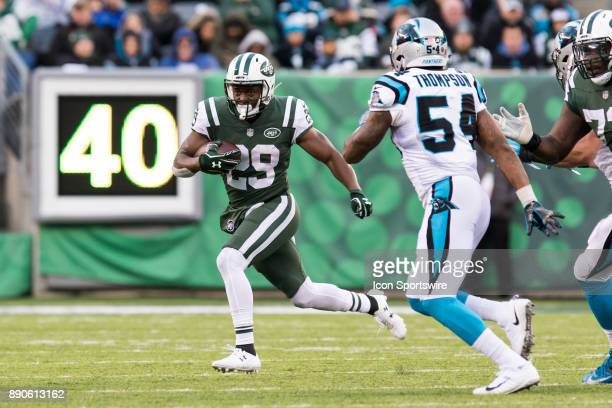 New York Jets Runningback Bilal Powell rushes with the ball during the second half of a regular season NFL game between the Carolina Panthers and the...