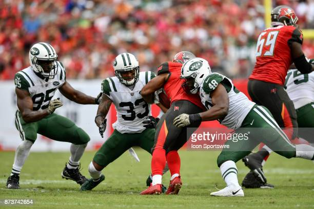 New York Jets safety Jamal Adams and New York Jets linebacker Jordan Jenkins tackle Tampa Bay Buccaneers running back Doug Martin during the second...