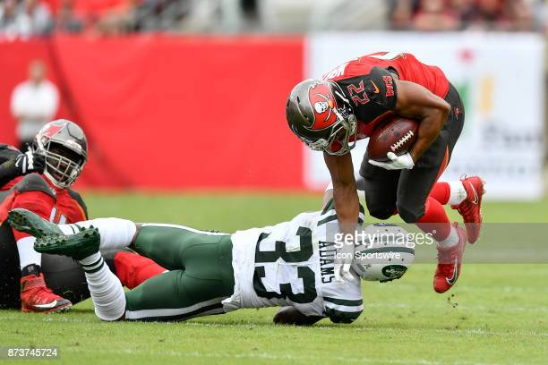 New York Jets safety Jamal Adams tackles Tampa Bay Buccaneers running back Doug Martin during the first half of an NFL game between the New York Jets...