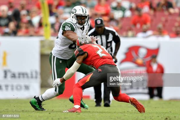 New York Jets tight end Austin SeferianJenkins is tackled after a reception by Tampa Bay Buccaneers safety Justin Evans during the second half of an...