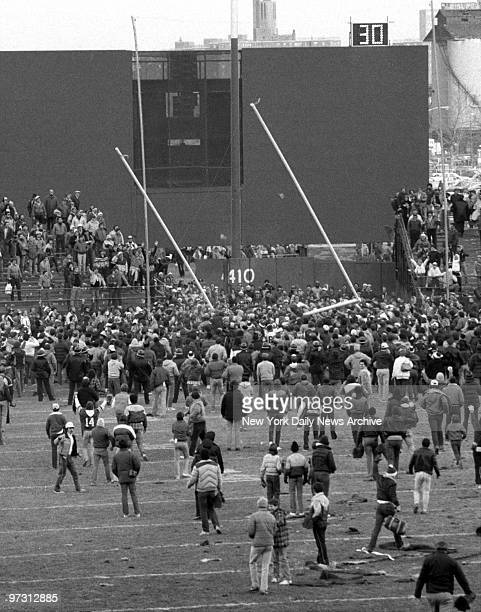 New York Jets vs Pittsburgh SteelersFans yanks goal posts from the ground at Shea Stadium at the New York Jets last game before their move to the...